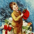 Free vintage clip art Christmas postcard Ellen Clapsaddle boy pinning holly and berries to hat